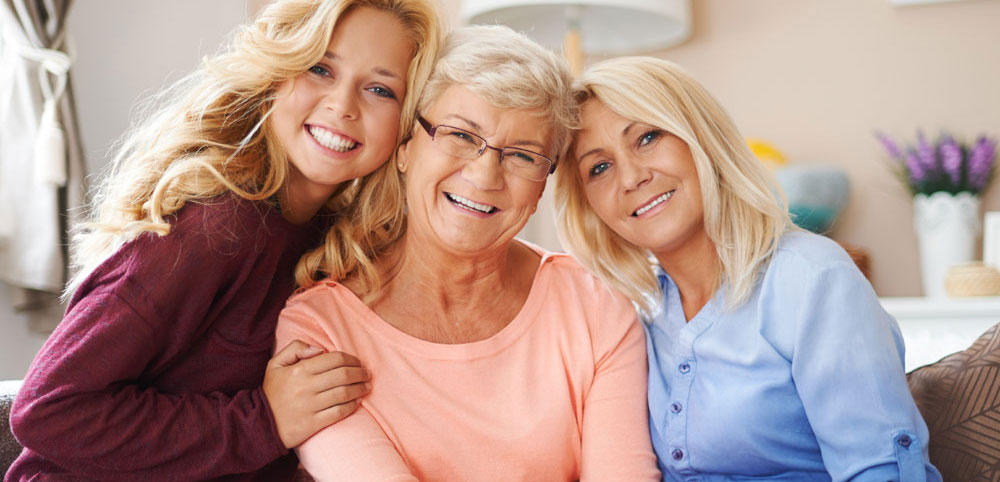 Three generations of women smiling